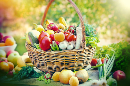 Fresh organic fruit and vegetable , healthy food in wicker basket on table Reklamní fotografie