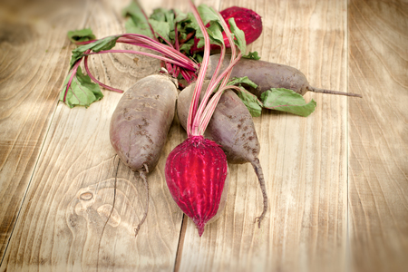 Fresh organic beet - beetroot on wooden table