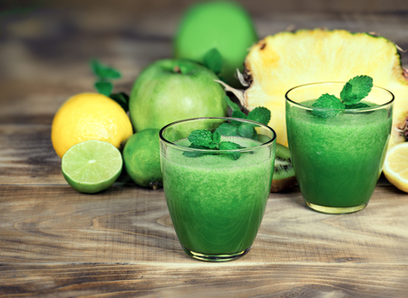 Healthy green smoothie, refreshing and healthy drink - green smoothie made with fresh organic fruit Reklamní fotografie