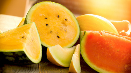 Watermelon, cantaloupe (melon) - sweet, juicy and refreshing fruit in warm summer days Stock Photo