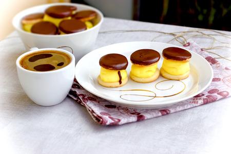 Cream cake and black coffee, coffee breaks and treat for pleasure 写真素材