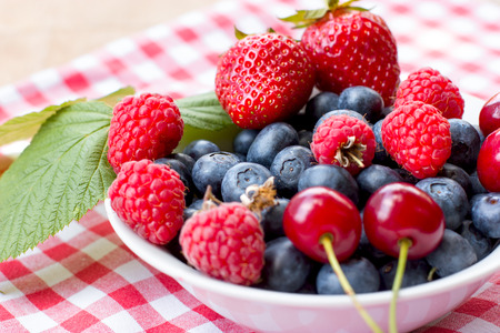 Forest berry, healty organic fruit in bowl closeup