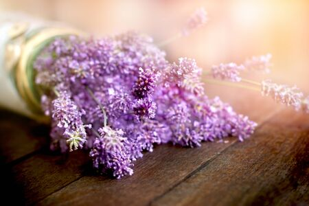 Lavender flowers in vase on rustic table, beautiful bouquet of flowers Stock Photo