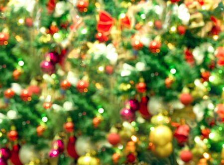 Christmas tree, decorations, lanterns and lighting in de focus