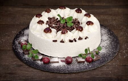 Creamy fruit cake, delicious cake with whipped cream, sour cherry and dark chocolate - Schwarzwald cake Stock Photo