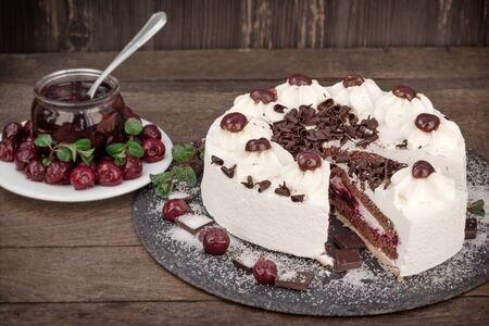 Slice of Schwarzwald cake, delicious creamy fruit and chocolate cake with whipped cream, sour cherry and dark chocolate - Black forest cake