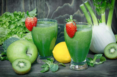 Healthy green smoothie on table, strong antioxidant 写真素材