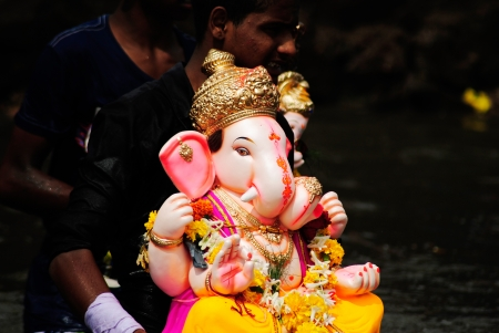 end of a long day:  Visarjan is the end of the ten-day long Ganesh Puja  Stock Photo