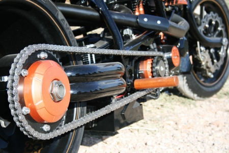 Nice motorbike chain. Black and orange pieces.