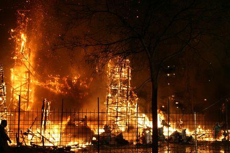 detonation: Burning Falla in Valencia. Big column of fire and cloud of smoke