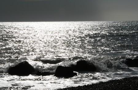 Stones in the dark beach Stock Photo - 4238885