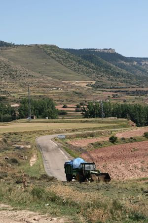 Old woodcutting tractor in mountains photo