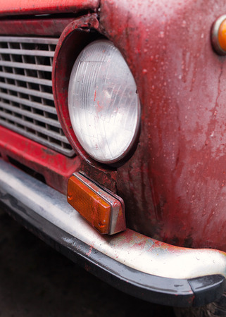 salvaging: Fragment of old red rusty car