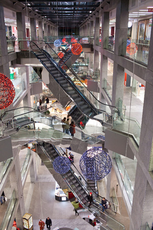 purchasers: DNEPROPETROVSK, UKRAINE - MARCH 29, 2014: Interior of shopping mall Passage - an ideal place for a comfortable shopping Editorial