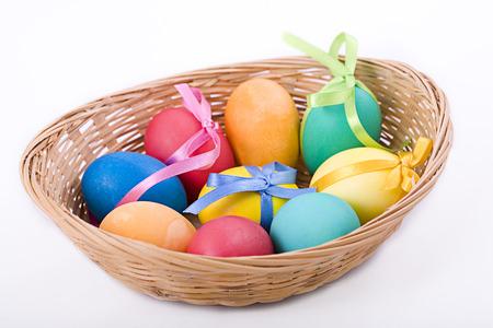 Easter eggs in a wicker basket photo