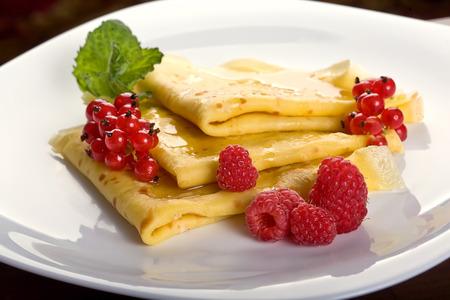 pancake week: Pancakes with berries and honey Stock Photo