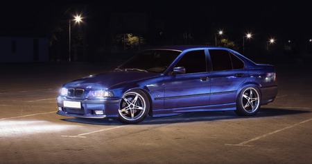 Sports car (BMW E36) headlights turned Editorial