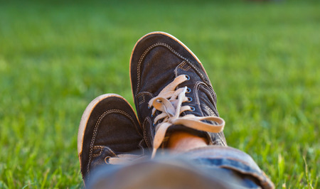 gym shoes: Legs in gym shoes on grass background