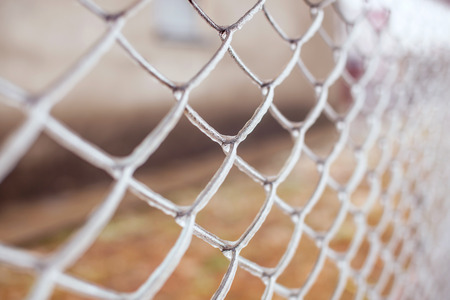 implications: Ice-covered metal mesh after freezing rain