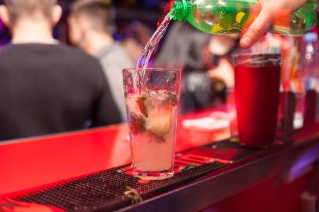 barman: Barman making cocktail at the night club