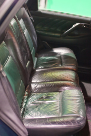 leathern: The rear seats of the old car , fragment Stock Photo