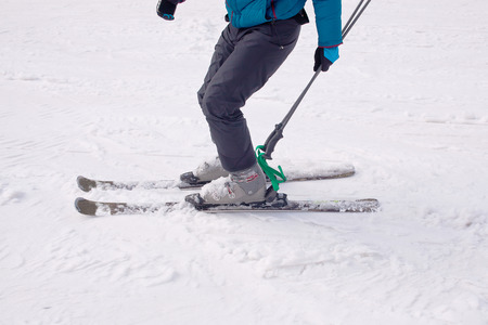 descends: A skier descends from the mountain, fragment Stock Photo