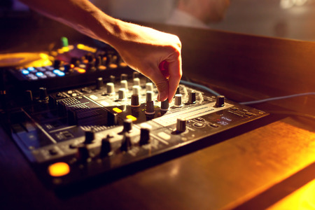 dj party: DJ mixing music on console at the night club Stock Photo