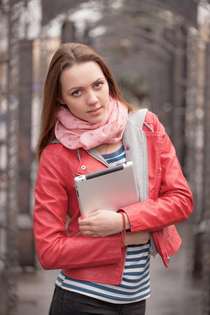 Young woman stay on streer with digital tablet
