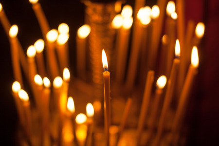 church group: Group of candles in church.