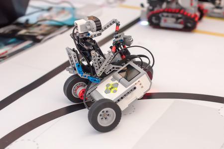 Black plastic mechanical robot on bike.