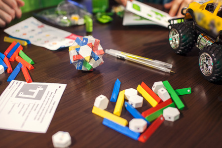 3 4 years: Colored wooden blocks on table.