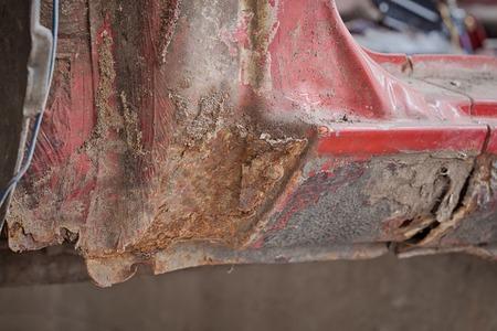 salvaging: Closeup photo of element rusty car. Stock Photo