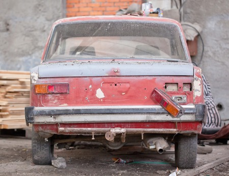 salvaging: Repair of the old red car Stock Photo