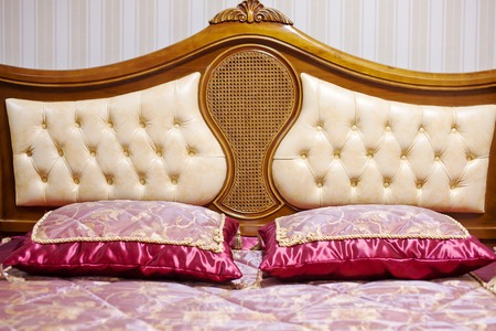 bedstead: Double bed with decorative headboard.