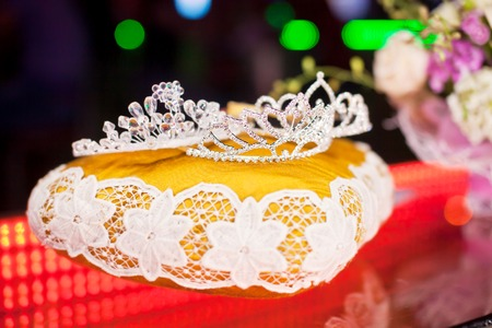 beauty contest: Three crown for the winner of the beauty contest on the decorative pillow