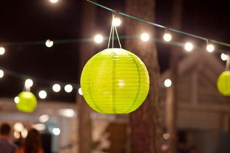 outdoor lighting: Green paper lantern outdoor party.