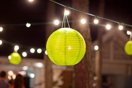 Green paper lantern outdoor party.