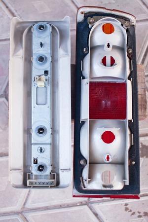 salvaging: Older disassembled rear car lights.