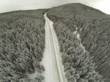 snowcovered: Aerial shot of snow-covered road in the countryside Carpathian Mountains. Stock Photo