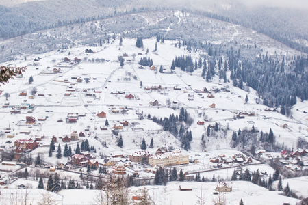 Mountain  village on the slopes of the Carpathian Mountains in winter. Ukraine. Stock Photo