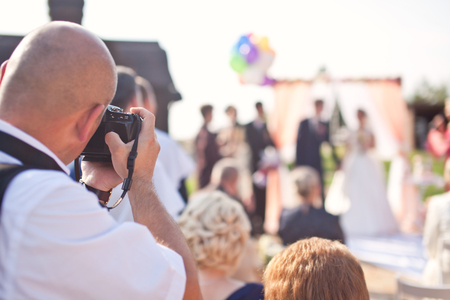 taking a wife: Photographer photographing a wedding ceremony