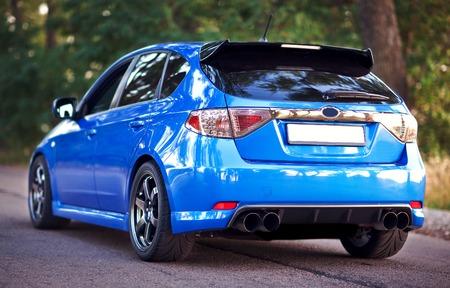 subaru: Rear side view of blue sport car.