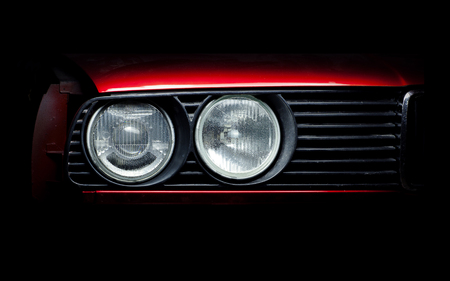 Headlights of the old red car close-up photo. Stock Photo