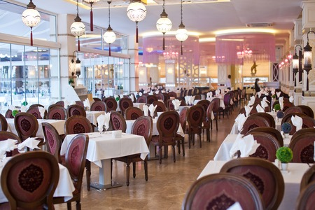 banqueting: Empty hall of the restaurant with brown chairs Stock Photo