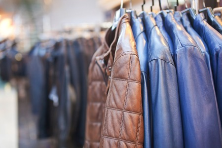 leathern: Collection of leather jackets on hangers in the shop. Stock Photo