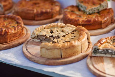 bake sale: Homemade pie  with different fillings on wooden boards. Stock Photo