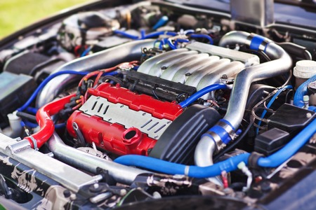 Close-up photo of modern turbocharged motor with pipe. Standard-Bild
