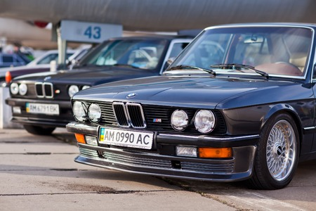 forepart: KYIV, UKRAINE - April 22, 2016: Car BMW e23 at festival of vintage cars OldCarLand-2016 in Kiev. Front side of a car close up. Editorial