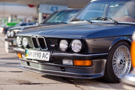 KYIV, UKRAINE - April 22, 2016: Car BMW e23 at festival of vintage cars OldCarLand-2016 in Kiev. Front side of a car close up. Editorial