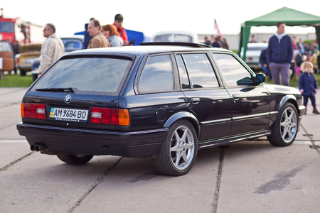 sunroof: KYIV, UKRAINE - April 22, 2016: Car BMW e30 at festival of vintage cars OldCarLand-2016 in Kiev. Side view rear.